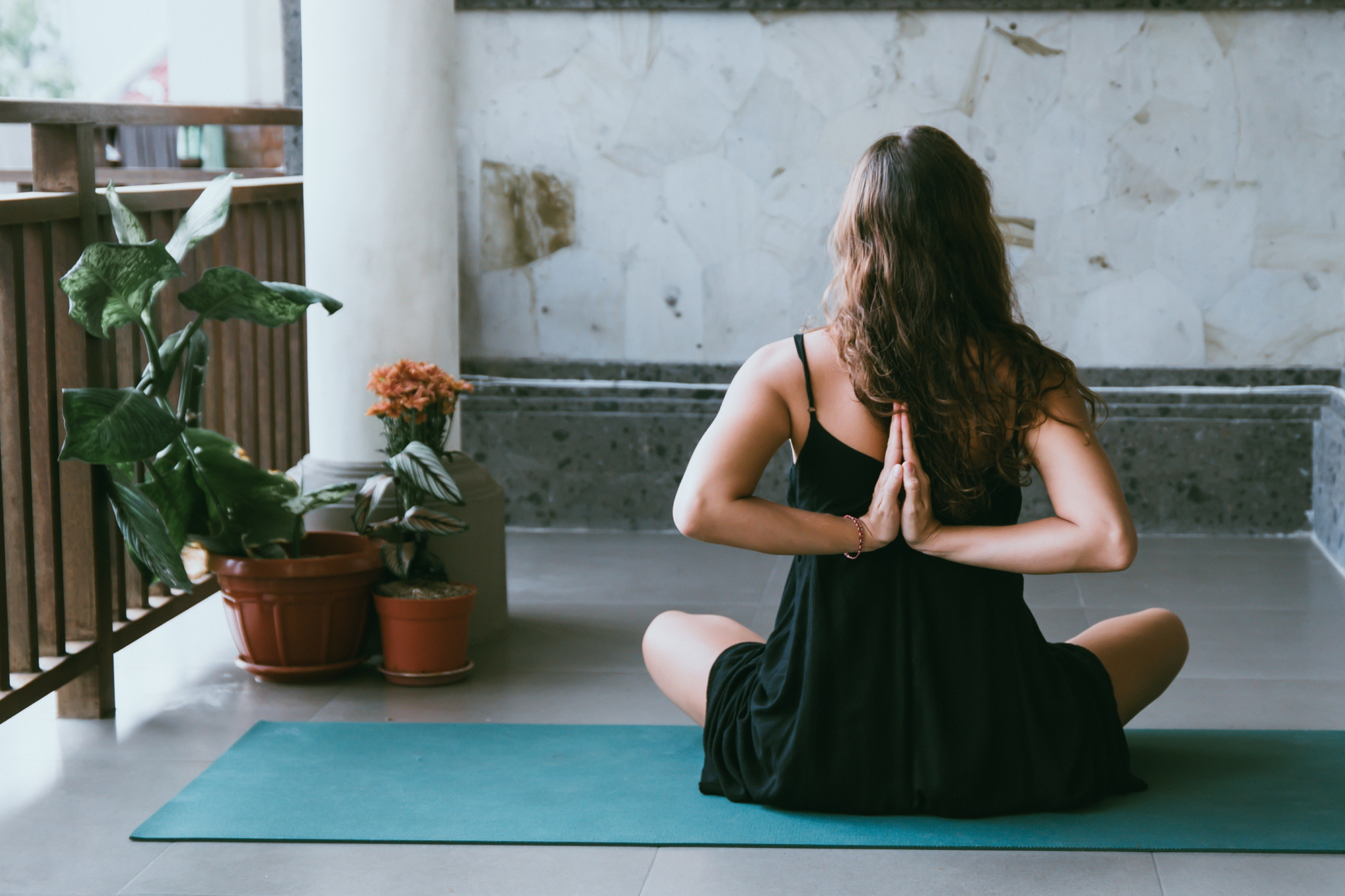 Image of woman in yoga pose with arms behind her back